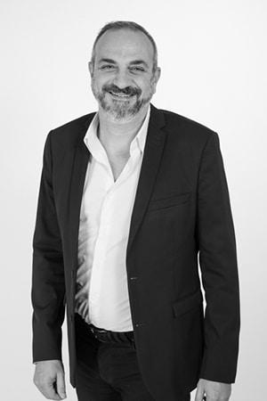 Photo de Franck La Pinta en noir et blanc - Franchisé Optimize360 PACA